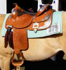 A heavy, Western show saddle.